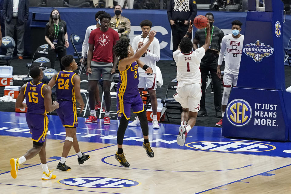 Alabama's Herbert Jones (1) scores the go-ahead layup in the final seconds to give Alabama the win over LSU in the championship game at the NCAA college basketball Southeastern Conference Tournament Sunday, March 14, 2021, in Nashville, Tenn. Alabama won 80-79. (AP Photo/Mark Humphrey)