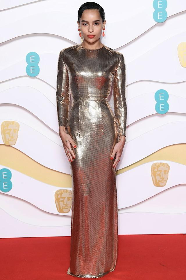 Zoë Kravitz looks gorgeous in a gold Saint Laurent gown at the 73rd British Academy Film Awards in London on Sunday.