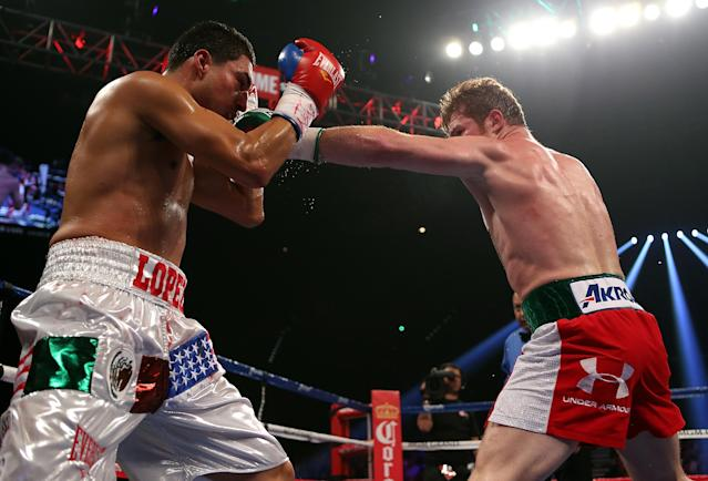LAS VEGAS, NV - SEPTEMBER 15: (R-L) Canelo Alvarez lands a left to the head of Josesito Lopez during their WBC super welterweight title fight at MGM Grand Garden Arena on September 15, 2012 in Las Vegas, Nevada. (Photo by Josh Hedges/Getty Images)