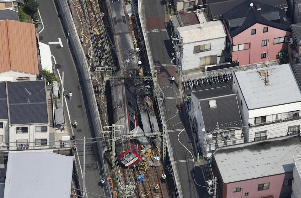 A train is seen as it is derailed after a collision with a truck in Yokohama, near Tokyo , Japan in this photo taken by Kyodo September 5, 2019.  Mandatory credit Kyodo/via REUTERS ATTENTION EDITORS - THIS IMAGE WAS PROVIDED BY A THIRD PARTY. MANDATORY CREDIT. JAPAN OUT. NO COMMERCIAL OR EDITORIAL SALES IN JAPAN.