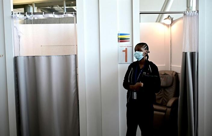 A nurse waits for patients at JFK International Airport's Terminal 4 XpresCheck, the first airport-based COVID-19 testing facility in the United States (AFP Photo/Johannes EISELE)