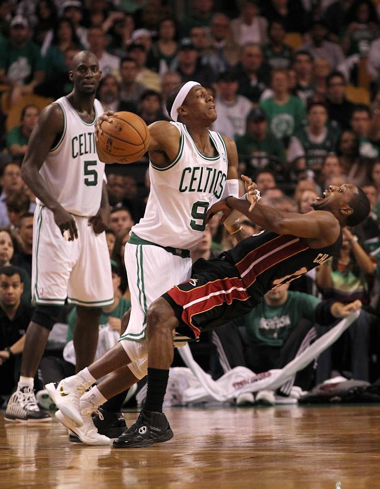 BOSTON, MA - JUNE 03:  Rajon Rondo #9 of the Boston Celtics drives against Mario Chalmers #15 of the Miami Heat in tthe second half of Game Four of the Eastern Conference Finals in the 2012 NBA Playoffs on June 3, 2012 at TD Garden in Boston, Massachusetts. NOTE TO USER: User expressly acknowledges and agrees that, by downloading and or using this photograph, User is consenting to the terms and conditions of the Getty Images License Agreement.  (Photo by Jim Rogash/Getty Images)