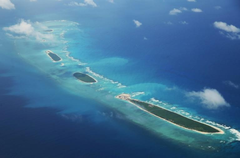 US warship sails near disputed islands in tense South China Sea