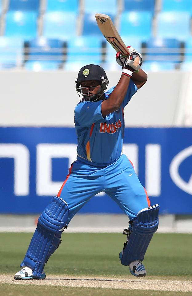 DUBAI, UNITED ARAB EMIRATES - FEBRUARY 17:  Sarfaraz Khan of India bats during the ICC U19 Cricket World Cup 2014 match between India and Scotland at the Dubai Sports City Cricket Stadium on February 17, 2014 in Dubai, United Arab Emirates.  (Photo by Francois Nel - IDI/IDI via Getty Images)