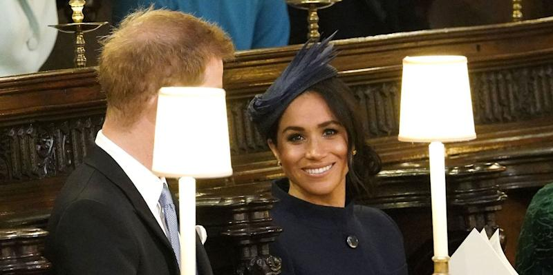 The Duchess of Sussex smiles in St. George's Chapel.