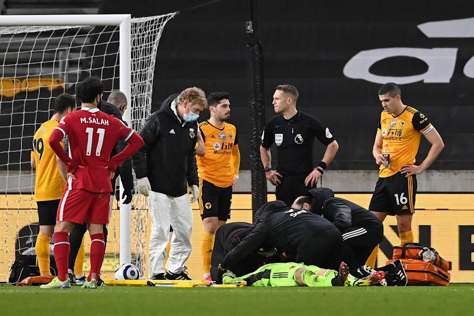 <p>Conor Coady watches on as Rui Patricio receives medical treatment</p> (Getty)