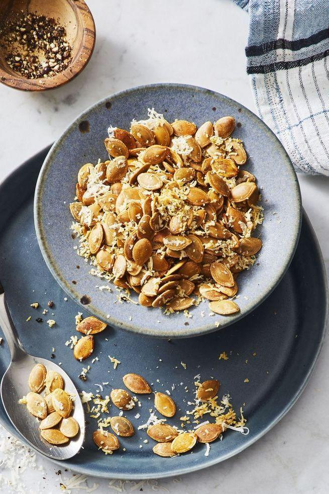"""<p>Pumpkin seeds are a great fall snack, and they work really well as an appetizer or small dish to pass around the table during a Thanksgiving meal. </p><p><strong><em>Get the recipe at <a href=""""https://www.goodhousekeeping.com/food-recipes/cooking/a25252173/how-to-roast-pumpkin-seeds/"""" rel=""""nofollow noopener"""" target=""""_blank"""" data-ylk=""""slk:Good Housekeeping"""" class=""""link rapid-noclick-resp"""">Good Housekeeping</a>. </em></strong> </p>"""