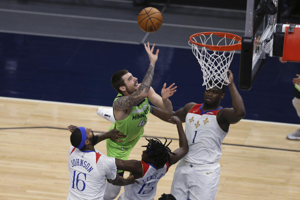 CORRECTS TIMBERWOLVES PLAYER TO JUANCHO HERNANGOMEZ, INSTEAD OF JAYLEN NOWELL - Minnesota Timberwolves' Juancho Hernangomez shoots after being fouled by New Orleans Pelicans' Kira Lewis Jr. (13) during the second half of an NBA basketball game Saturday, May 1, 2021, in Minneapolis. (AP Photo/Stacy Bengs)