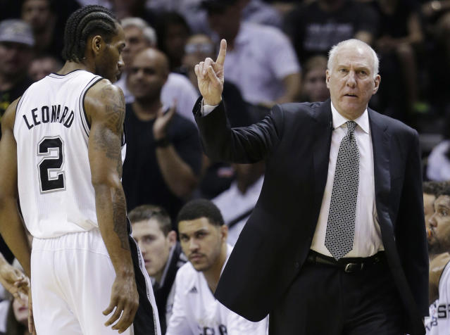 "<a class=""link rapid-noclick-resp"" href=""/nba/teams/sas"" data-ylk=""slk:San Antonio Spurs"">San Antonio Spurs</a> head coach Gregg Popovich could reunited with <a class=""link rapid-noclick-resp"" href=""/nba/players/4896/"" data-ylk=""slk:Kawhi Leonard"">Kawhi Leonard</a> at Team SA's minicamp. (AP Photo/David J. Phillip)"