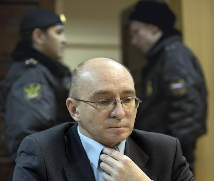 Dmitry Kratov, sits in a courtroom, in Moscow, Russia, Friday, Dec. 28, 2012. The Tverskoy court on Friday will rule in the case of Dmitry Kratov, formerly deputy chief physician in the Butyrskaya prison, the only official charged with the lawyer's death. The Moscow court is expected to hand down a verdict on Friday for the first and only official charged with the death of whistleblowing lawyer Sergei Magnitsky in a case his family dismissed as sham and humiliation. (AP Photo/Misha Japaridze)
