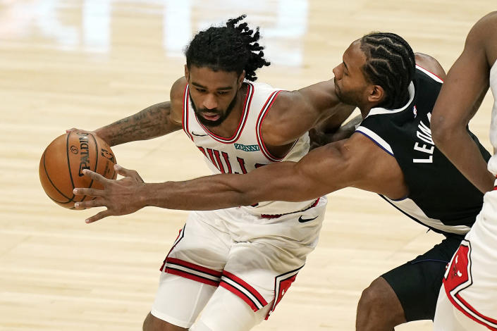 Los Angeles Clippers forward Kawhi Leonard, right, steals the ball from Chicago Bulls guard Coby White during the second half of an NBA basketball game Sunday, Jan. 10, 2021, in Los Angeles. (AP Photo/Marcio Jose Sanchez)