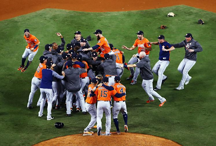 The Houston Astros celebrate defeating the Los Angeles Dodgers 5-1 in game seven to win the 2017 World Series. (Getty Images)