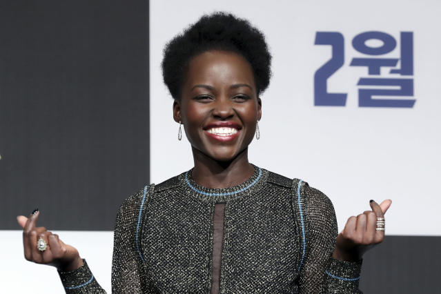 "Lupita Nyong'o pulls a double finger heart at the Seoul premiere of ""Black Panther"" earlier this month. (Han Myung-Gu/Getty Images)"