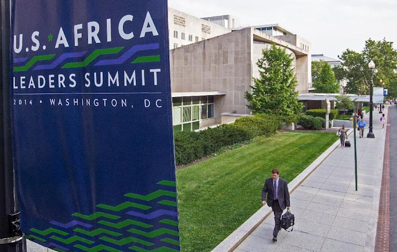 A sign is seen promoting the US-Africa Leaders Summit is seen July 31, 2014 outside the US Department of State (L) where President Obama will host African Leaders August 4-6,2014 in Washington, DC (AFP Photo/Paul J. Richards )