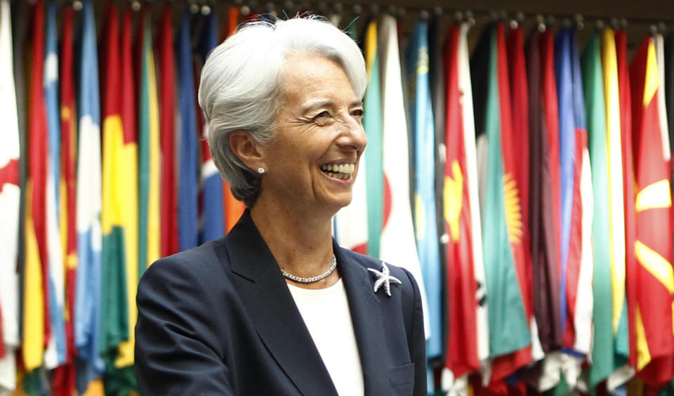 Former French Finance Minister Christine Lagarde smiles as she arrives at the International Monetary Fund headquarters for her first day as head of the IMF in Washington July 5, 2011.     REUTERS/Kevin Lamarque  (UNITED STATES - Tags: BUSINESS HEADSHOT POLITICS)