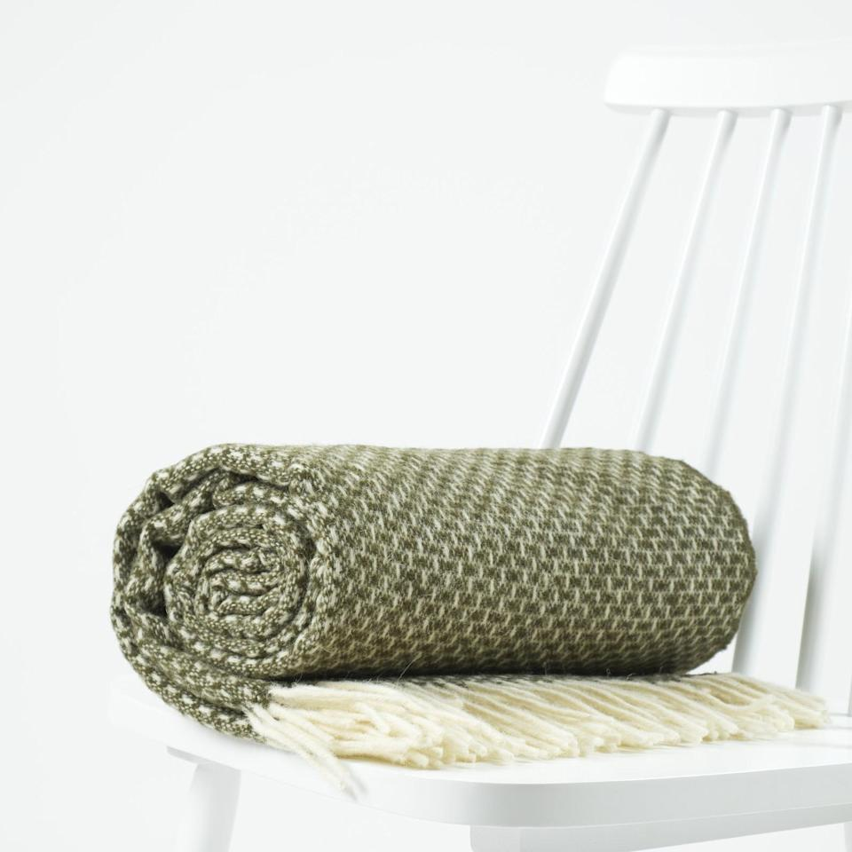 <p>This <span>Textured Blanket</span> ($65, originally $72) is meant to be curled up in all day.</p>