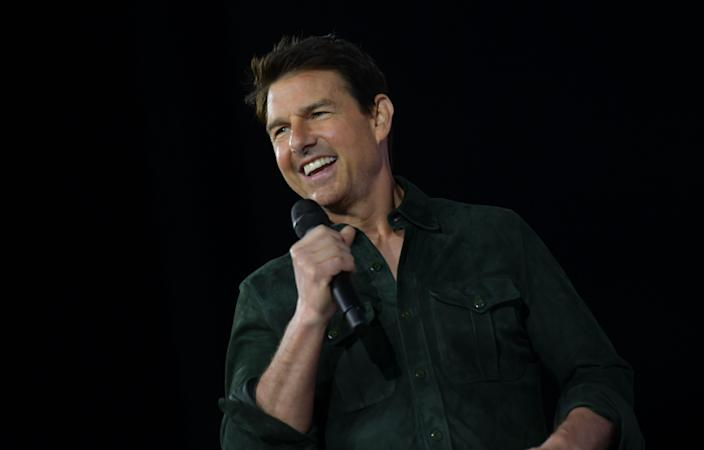 Tom Cruise makes a surprise appearance to promote 'Top Gun: Maverick' at Comic Con on July 18, 2019. (Photo by Chris Delmas/AFP via Getty Images)