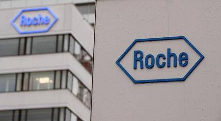 FILE PHOTO: The logo of Swiss drugmaker Roche is seen at its headquarters in Basel, Switzerland February 1, 2018. REUTERS/Arnd Wiegmann/File Photo