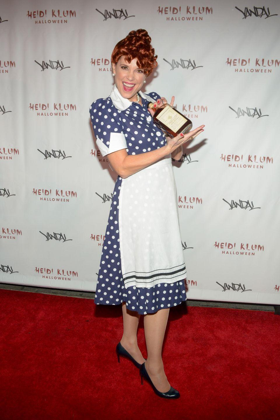 """<p>Pair a polka-dot dress and an apron with an updo to become comedic legend Lucille Ball. </p><p><strong>What You'll Need:</strong> <a href=""""https://www.amazon.com/DRESSTELLS-Blue-Small-White-Dot/dp/B07BPSN2Q9?tag=syn-yahoo-20&ascsubtag=%5Bartid%7C10070.g.28166042%5Bsrc%7Cyahoo-us"""" rel=""""nofollow noopener"""" target=""""_blank"""" data-ylk=""""slk:blue polka-dot dress"""" class=""""link rapid-noclick-resp"""">blue polka-dot dress</a>, <a href=""""https://www.amazon.com/Uncommon-Threads-Unisex-Waist-Apron/dp/B00EYH3OIK?tag=syn-yahoo-20&ascsubtag=%5Bartid%7C10070.g.28166042%5Bsrc%7Cyahoo-us"""" rel=""""nofollow noopener"""" target=""""_blank"""" data-ylk=""""slk:white apron"""" class=""""link rapid-noclick-resp"""">white apron</a>, and <a href=""""https://www.amazon.com/Guilty-Shoes-Womens-Classic-Closed/dp/B08J7XB3B3?tag=syn-yahoo-20&ascsubtag=%5Bartid%7C10070.g.28166042%5Bsrc%7Cyahoo-us"""" rel=""""nofollow noopener"""" target=""""_blank"""" data-ylk=""""slk:black heels"""" class=""""link rapid-noclick-resp"""">black heels</a></p>"""
