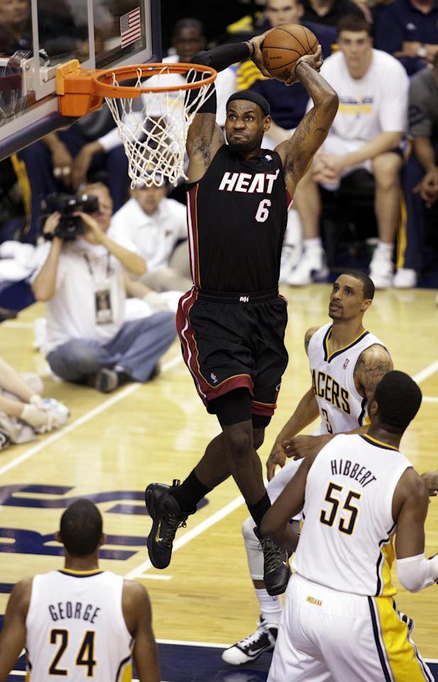 Miami Heat forward LeBron James (6) dunks in front of Indiana Pacers' George Hill (3), Roy Hibbert (55) and Paul George (24) during the second half of Game 4 of their NBA basketball Eastern Conference semifinal playoff series, Sunday, May 20, 2012, in Indianapolis. (AP Photo/AJ Mast)