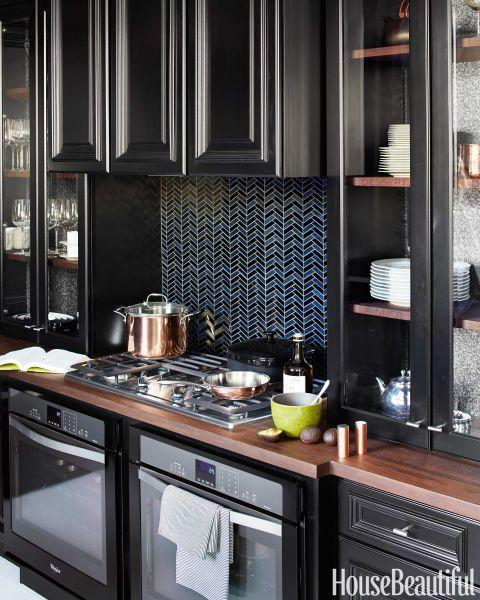 """<p>In our 2014 Kitchen of the Year, we see the emergence of darker cabinets, along with smart appliances that emphasize maximum efficiency (like the Whirlpool Gold Wall Ovens, which have a rapid preheat function). </p><p><a href=""""http://www.housebeautiful.com/room-decorating/kitchens/g1964/2014-kitchen-of-the-year/?slide=2"""" rel=""""nofollow noopener"""" target=""""_blank"""" data-ylk=""""slk:See more of the 2014 Kitchen of the Year »"""" class=""""link rapid-noclick-resp""""><em>See more of the 2014 Kitchen of the Year »</em></a></p>"""