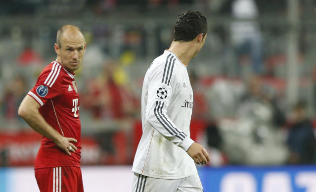 Bayern's Arjen Robben, left, looks to Real's Cristiano Ronaldo who scored his side's fourth goal during the Champions League semifinal second leg soccer match between Bayern Munich and Real Madrid at the Allianz Arena in Munich, southern Germany, Tuesday, April 29, 2014. (AP Photo/Matthias Schrader)