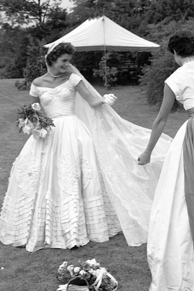 <p>Jackie was a vision on her wedding day to John Kennedy in 1953. Recently, Megan Markle recently proved the boatneck wedding gown to be as timeless as we always knew it to be.</p>