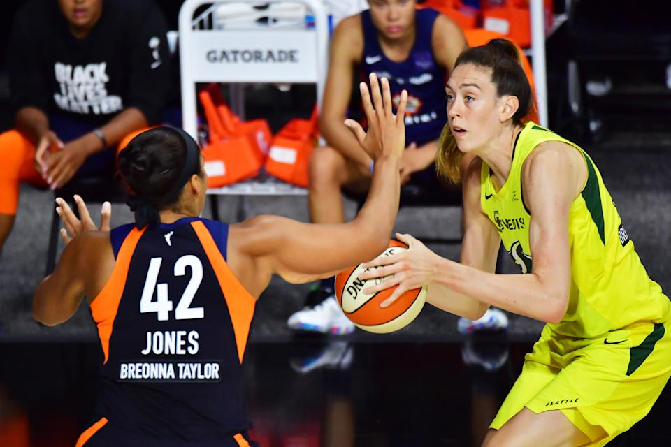 PALMETTO, FLORIDA - AUGUST 16: Breanna Stewart #30 of the Seattle Storm looks to shoot from beyond the three point line over Brionna Jones #42 of the Connecticut Sun during the first half of a game at Feld Entertainment Center on August 16, 2020 in Palmetto, Florida. NOTE TO USER: User expressly acknowledges and agrees that, by downloading and or using this photograph, User is consenting to the terms and conditions of the Getty Images License Agreement. (Photo by Julio Aguilar/Getty Images)