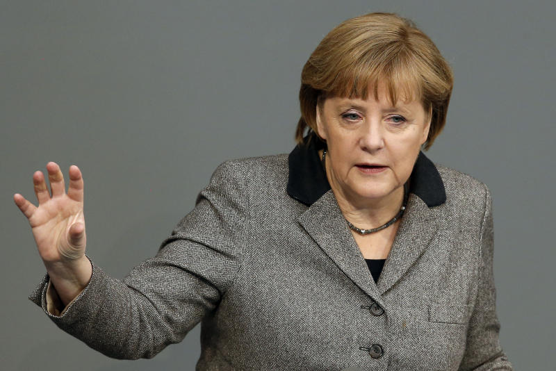German Chancellor Angela Merkel gestures during a government statement as part of a meeting of the German federal parliament, Bundestag, in Berlin, Germany, Thursday, Feb. 21, 2013. (AP Photo/Michael Sohn)