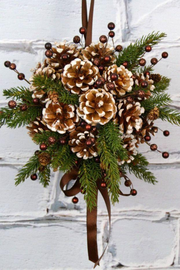 "<p>Forget mistletoe—kissing balls are <em>it</em> this year. This pine and pinecone version is a perfect addition to any doorway, and requires just a <a href=""https://www.amazon.com/FloraCraft-Packaged-Styrofoam-5-Inch-Snowball/dp/B0019IFZDY?tag=syn-yahoo-20&ascsubtag=%5Bartid%7C10057.g.3952%5Bsrc%7Cyahoo-us"" rel=""nofollow noopener"" target=""_blank"" data-ylk=""slk:foam ball"" class=""link rapid-noclick-resp"">foam ball</a>, <a href=""https://www.amazon.com/Seal-Brown-Double-Satin-Ribbon/dp/B00CLET5G8?tag=syn-yahoo-20&ascsubtag=%5Bartid%7C10057.g.3952%5Bsrc%7Cyahoo-us"" rel=""nofollow noopener"" target=""_blank"" data-ylk=""slk:ribbon"" class=""link rapid-noclick-resp"">ribbon</a>, and greenery from your backyard. Get the tutorial at <a href=""http://blog.consumercrafts.com/decor-home/pine-cone-diy-kissing-ball/"" rel=""nofollow noopener"" target=""_blank"" data-ylk=""slk:Consumer Crafts"" class=""link rapid-noclick-resp"">Consumer Crafts</a>.</p>"