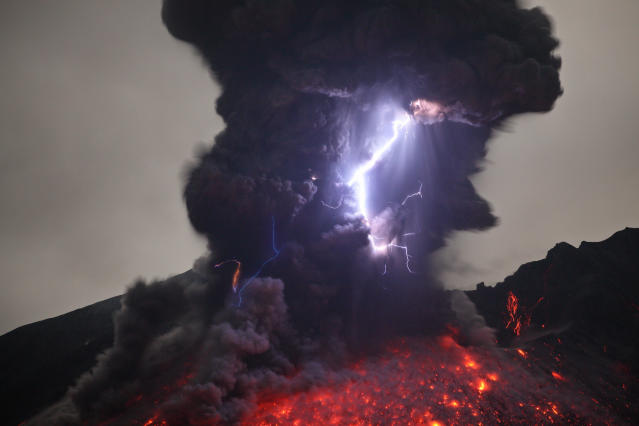 PIC FROM MARTIN RIETZE / GUZELIAN - (PICTURED - Lightning can be seen emerging through the lava eruption) A thrill-seeking volcano chaser witnessed the rare moment a lightning storm collided with an erupting stream of lava. These lightstorm images were caught up close by photographer Martin Rietze who hunts out this exploding phemomena in active volcanos right across the world. This light spectacle was pictured 3-4km east of the Sakurajima Volcano in the Kaghoshima area of South Japan. - SEE CATERS COPY **NOT FOR SALE IN GERMANY / AUSTRIA**