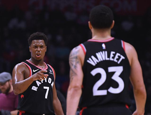 Kyle Lowry celebrates a 103-74 lead with Fred VanVleet at the end of the third quarter at Staples Center on December 11, 2018 in Los Angeles, California. (Photo by Harry How/Getty Images)