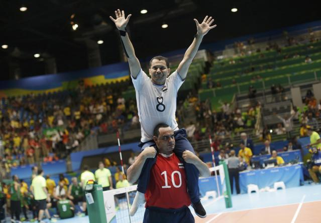 2016 Rio Paralympics - Sitting Volleyball - Men's Bronze Medal Match - Riocentro Pavilion 6 - Rio de Janeiro, Brazil - 18/09/2016. Hossam Massoud and Abdelnaby Abdellatif (EGY) of Egypt celebrate. REUTERS/Ueslei Marcelino FOR EDITORIAL USE ONLY. NOT FOR SALE FOR MARKETING OR ADVERTISING CAMPAIGNS.