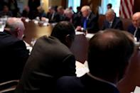Secretary of Housing and Urban Development (HUD) Ben Carson (bottom center) leads U.S. President Donald Trump and his cabinet in prayer before a meeting at the White House in Washington, U.S., December 20, 2017. REUTERS/Jonathan Ernst