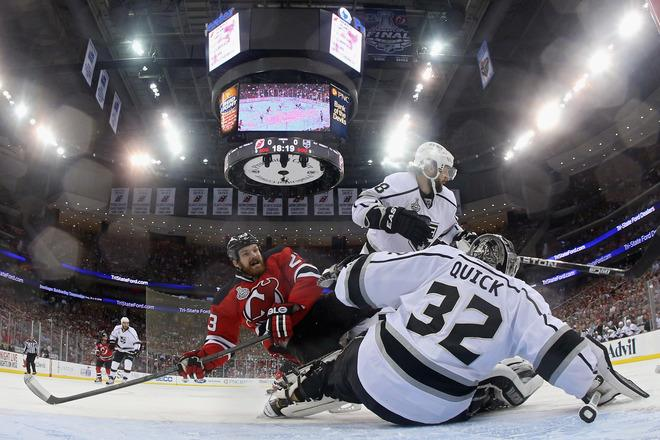NEWARK, NJ - JUNE 02:  David Clarkson #23 of the New Jersey Devils loses his balance in front of Jonathan Quick #32 and Drew Doughty #8 of the Los Angeles Kings during Game Two of the 2012 NHL Stanley Cup Final at the Prudential Center on June 2, 2012 in Newark, New Jersey.  (Photo by Bruce Bennett/Getty Images)