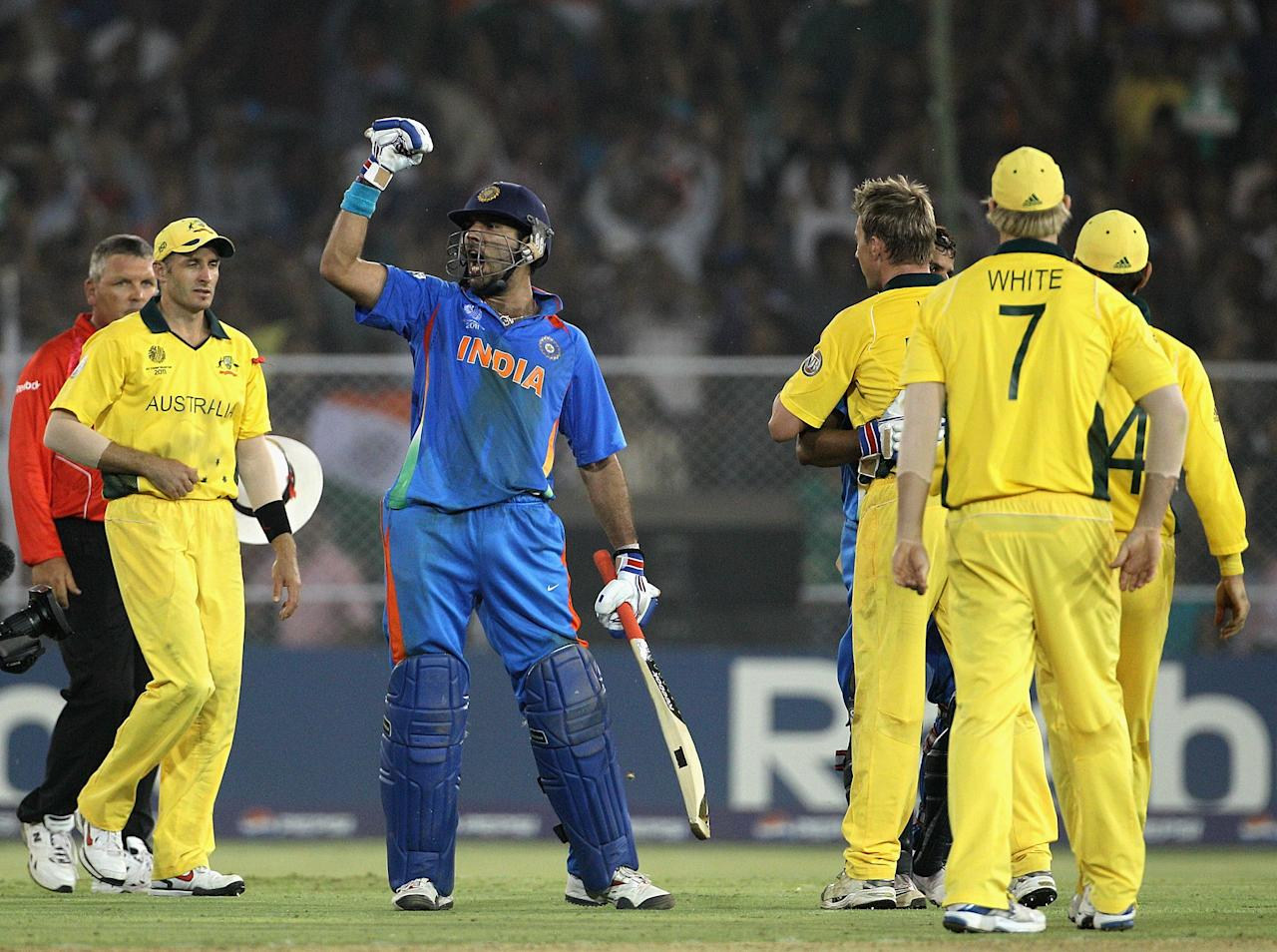 India vs Australia (Quarter-final) at Ahmedabad on 24 March 2011: Ricky Ponting scored 104, his first century in international cricket in over a year, in his last innings as full-time Australia captain and anchored the innings as he helped his team get through a middle-order slump as the three-time defending champions set India a target of 261.   India lost Virender Sehwag early in their run chase, but Gautam Gambhir (50) ensured panic wouldn't sent in the dressing room with his calm approach in the middle as well as useful partnerships with Sachin Tendulkar and Virat Kohli. When captain MS Dhoni was dismissed by Brett Lee, India still needed 74 runs to win in just over 12 overs. Yuvraj continued his good form with the bat and remained unbeaten on 57 from 65 deliveries, while Suresh Raina (34*) put the exclamation mark on an easy victory in the end as India overhauled the target in the 48th over to end Australia's domination of the World Cup.