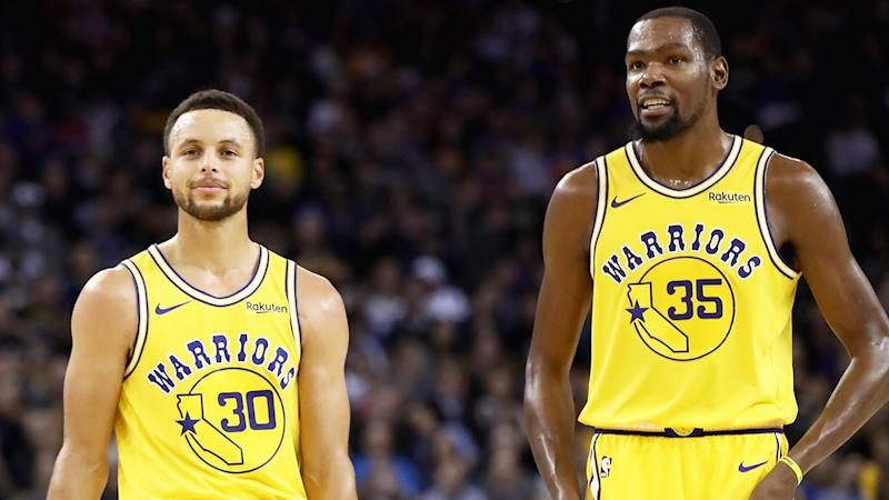 Steph Curry, pictured alongside former teammate Kevin Durant, says he prefers championships over iso-ball.
