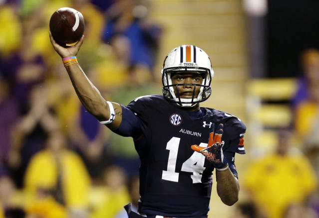 Auburn quarterback Nick Marshall (14) passes in the second half of an NCAA college football game against LSU in Baton Rouge, La., Saturday, Sept. 21, 2013. LSU won 35-21. (AP Photo/Gerald Herbert)