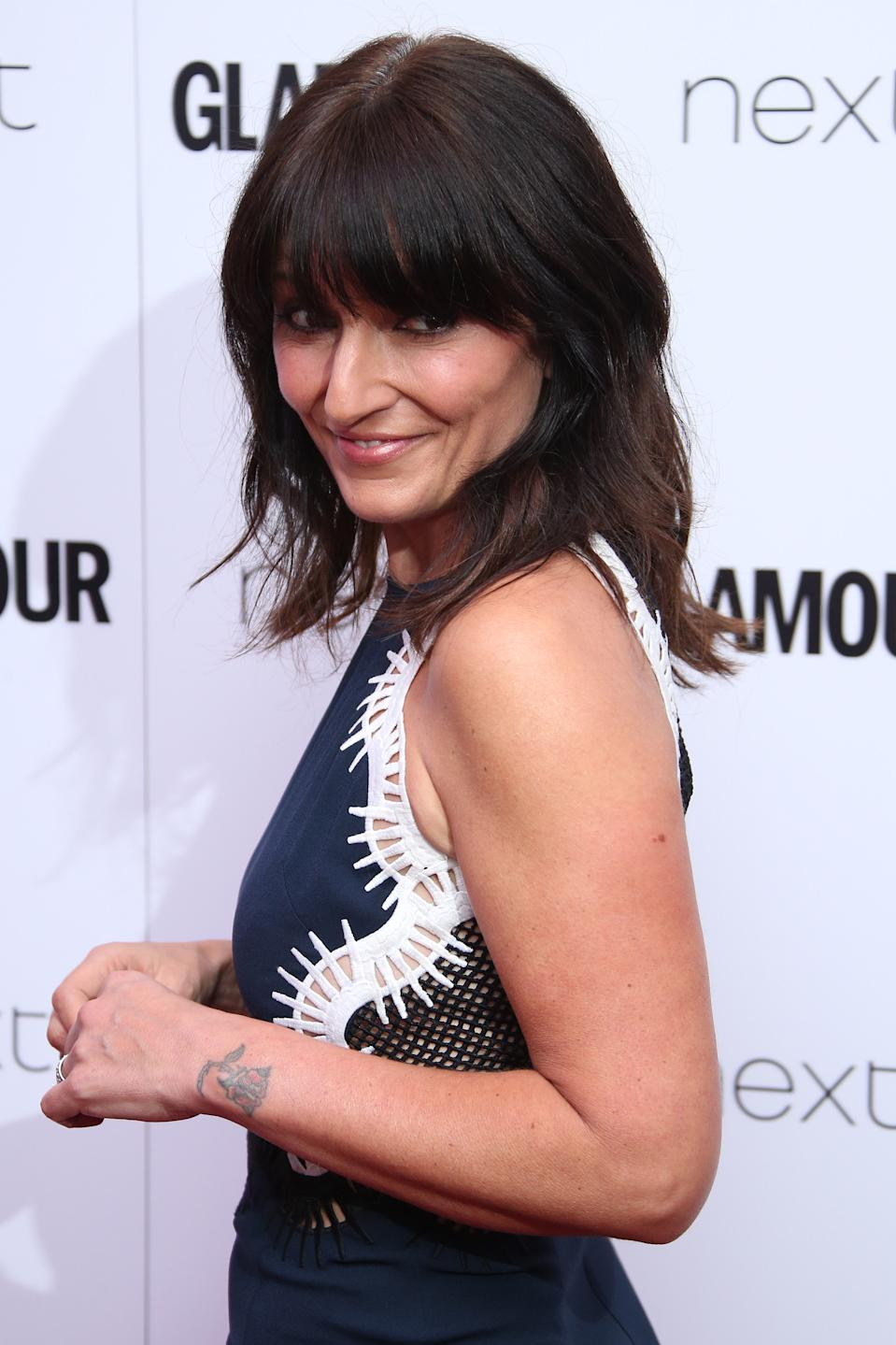 Davina McCall poses for photographers upon arrival at the Glamour Woman of the Year Awards in London, Tuesday, June 7, 2016. (Photo by Joel Ryan/Invision/AP)