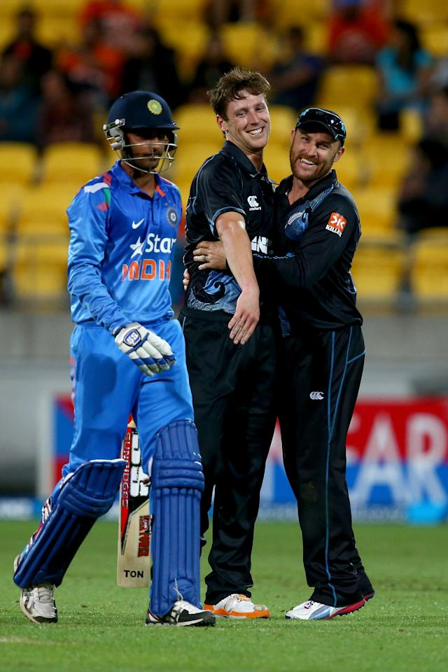 WELLINGTON, NEW ZEALAND - JANUARY 31:  Matt Henry of New Zealand (C) celebrates his wicket of Bhuvneshwar Kumar of India (L) with Brendon McCullum (R) during Game 5 of the men's one day international between New Zealand and India at Westpac Stadium on January 31, 2014 in Wellington, New Zealand.  (Photo by Phil Walter/Getty Images)
