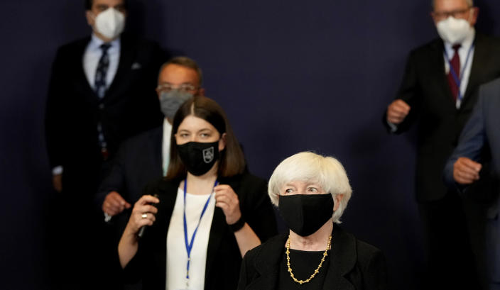 U.S. Treasury Secretary Janet Yellen, center, poses for a group photo of eurogroup finance ministers at the European Council building in Brussels on Monday, July 12, 2021. (AP Photo/Virginia Mayo)