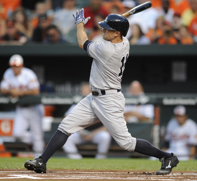New York Yankees Brett Gardner follows through on a solo home run against the Baltimore Orioles in the first inning of a baseball game, Sunday, July 13, 2014, in Baltimore.(AP Photo/Gail Burton)