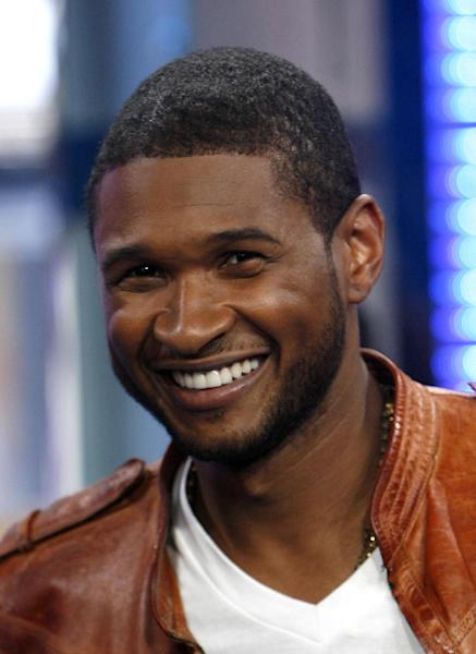 "** FILE ** In this May 27, 2008 file photo, Usher is shown on MTV's Total Request Live in New York. NBC says on Monday, Sept. 17, 2012 that Usher and Shakira are joining ""The Voice"" as new coaches next spring, when Christina Aguilera and CeeLo Green take a break from the show. (AP Photo/Jason DeCrow, file)"