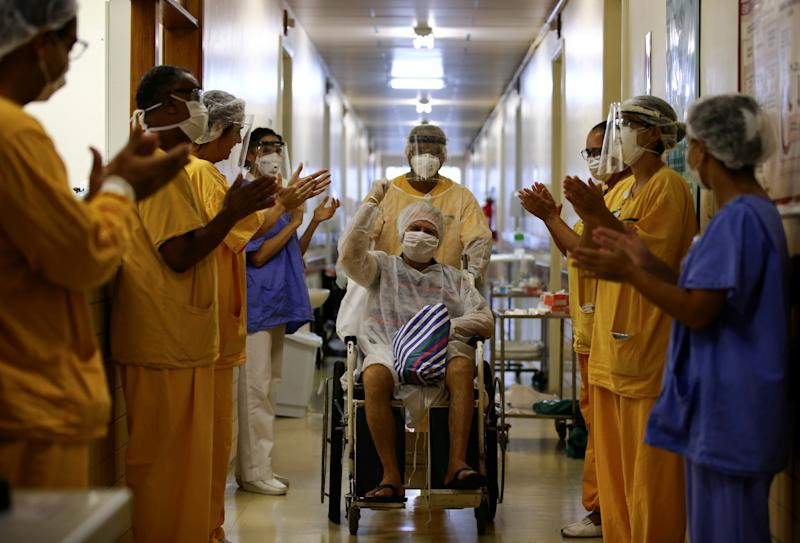 Lauro Riff Viegas, 69, gestures as he leaves the Nossa Senhora da Conceicao Hospital, after being treated for the coronavirus disease (COVID-19) and discharged, in Porto Alegre, Brazil, April 27, 2020. REUTERS/Diego Vara TPX IMAGES OF THE DAY