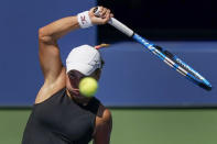 Yulia Putintseva, of Kazakhstan, returns a shot to Jennifer Brady, of the United States, during the quarterfinals of the US Open tennis championships, Tuesday, Sept. 8, 2020, in New York. (AP Photo/Seth Wenig)