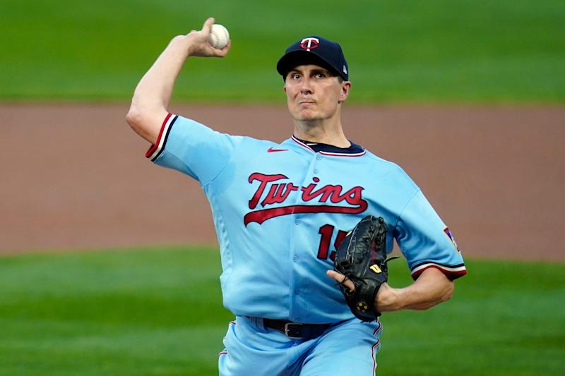 Minnesota Twins pitcher Homer Bailey throws against the Detroit Tigers in the first inning of a baseball game Tuesday, Sept. 22, 2020, in Minneapolis. (AP Photo/Jim Mone)