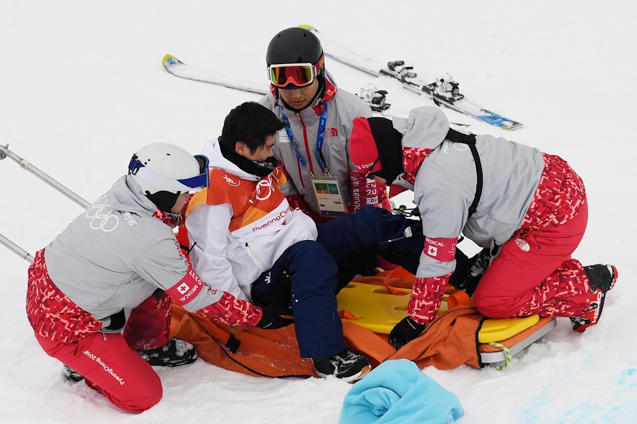 <p>Yuto Totsuka of Japan is attended to by medical staff after crashing in the during the Snowboard Men's Halfpipe Final on day five of the PyeongChang 2018 Winter Olympics at Phoenix Snow Park on February 14, 2018 in Pyeongchang-gun, South Korea. (Photo by Matthias Hangst/Getty Images) </p>