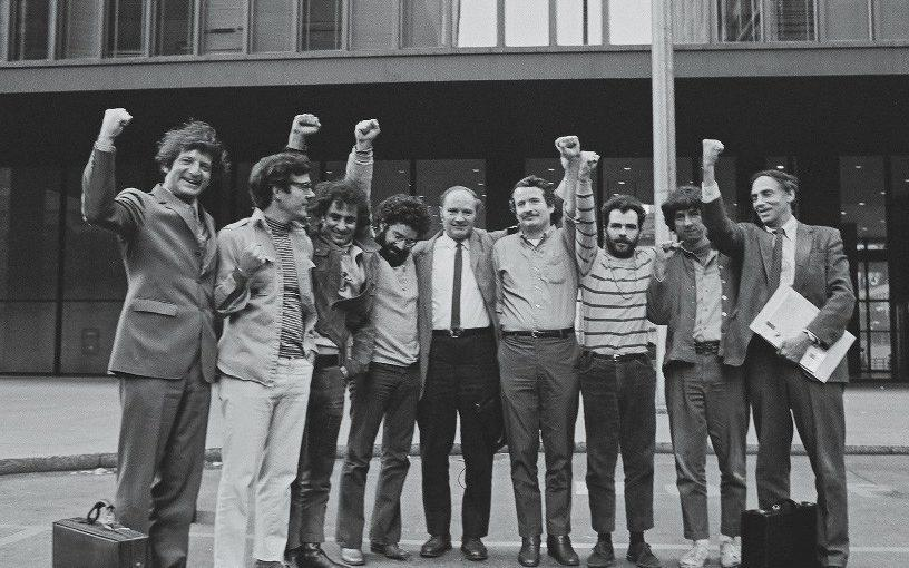 The Chicago Seven defendants and their lawyers outside court in 1969 - David Fenton