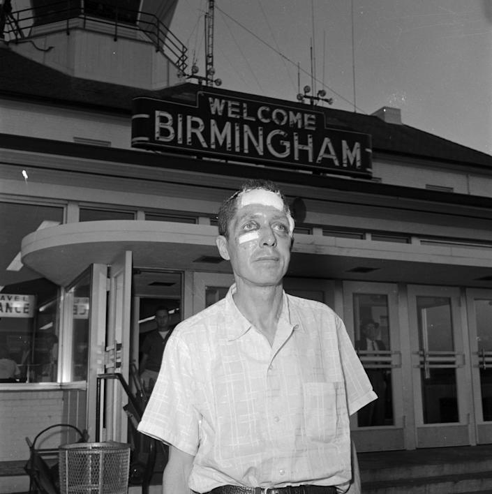 Freedom Rider James Peck leaving the airport in Birmingham, Alabama, to board a flight for New Orleans.