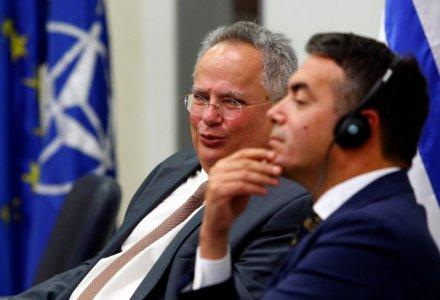 FILE PHOTO - Macedonian Foreign Minister Nikola Dimitrov (R) meets with Greek Foreign Minister Nikos Kotzias in Skopje, Macedonia August 31, 2017. REUTERS/Ognen Teofilovski
